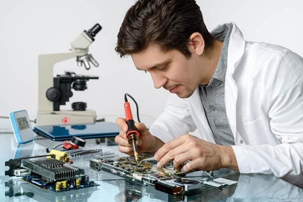 Technician repairing microscope
